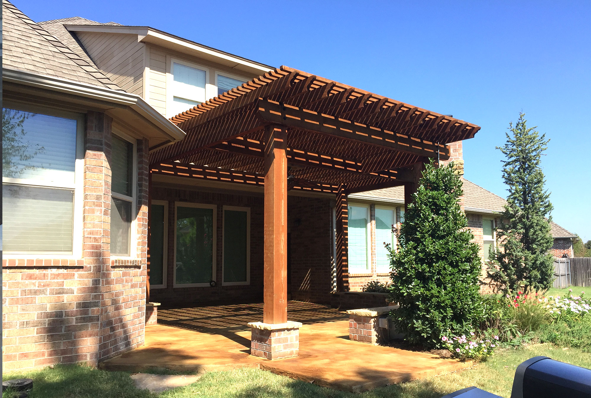 cedar pergola attached to back of house